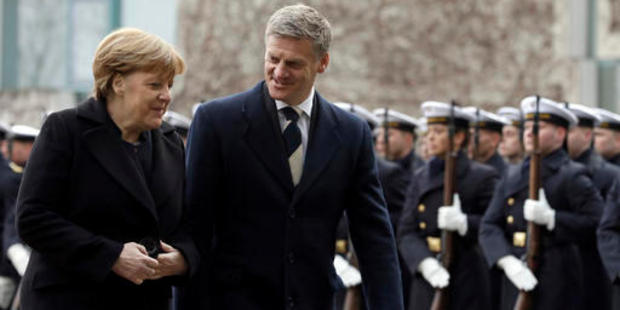 German Chancellor Angela Merkel welcomes New Zealand Prime Minister Bill English with military honours for a meeting in Berlin. Photo / AP