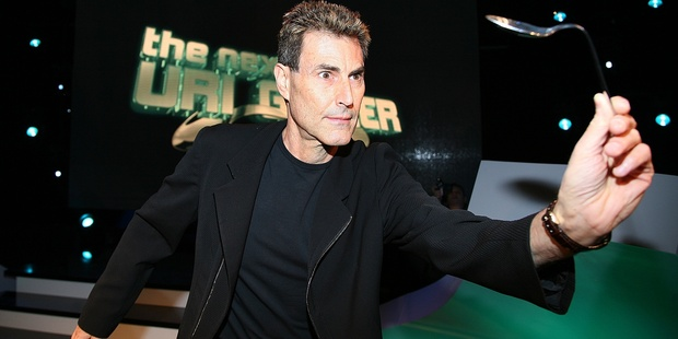 Uri Geller apparently bends spoon with his mind. Photo / Getty Images