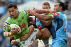 Josh Papali'i is tackled against the Gold Coast Titans. Photo / Getty Images