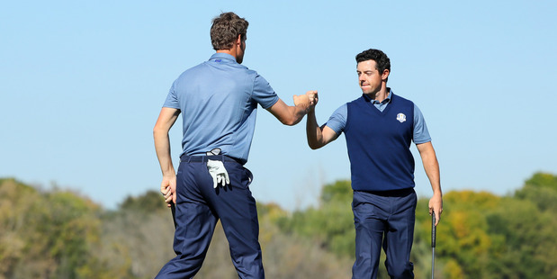Thomas Pieters and Rory McIlroy of Europe react on the seventh green. Photo / Getty Images