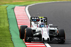 Sparks fly behind Valtteri Bottas' Williams in Japan. Photo / Getty Images