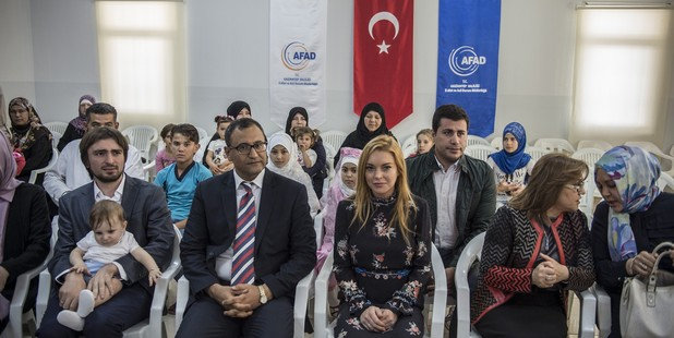 American actress Lindsay Lohan visits a container town where Syrian refugees live in the Nizip district of Gaziantep in Turkey on October 08, 2016.  Photo / Getty