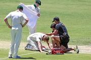 Adam Voges receives treatment after being struck in the head by a bouncer. Photo / Getty Images