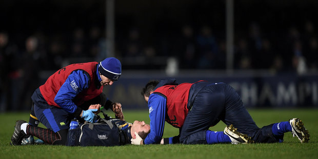 Loading Jonathan Sexton of Leinster is attended to by Leinster head physiotherapist Garreth Farrell and Dr Jim O'Donovan, Leinster team doctor. Photo/Getty Images
