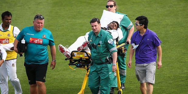 Imrul Kayes of Bangladesh is stretchered off after sustaining an injury. Photo / Getty