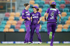 Amy Satterthwaite of the Hurricanes celebrates with team mates after taking the wicket of Rene Farrell. Photo / Getty Images