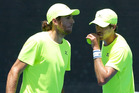 Marcelo Demoliner and Marcus Daniell talk tactics at the Australian Open. Photo / Getty Images