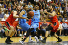 Kevin Dillard drives to the basket during the Breakers' encounter with Illawarra. Photo / Getty