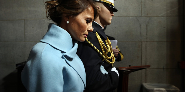 New US first lady Melania Trump chose one of America's most iconic designers for Inauguration Day ceremonies. See what everyone else wore. Photo / Getty Images