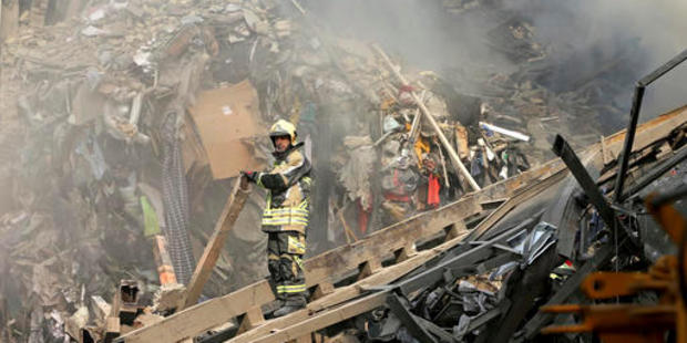 Loading Iranian firefighters work at the scene of the collapsed Plasco building, where 30 firefighters died when the building collapsed. Photo / AP