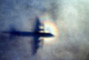 The shadow of a Royal New Zealand Air Force P3 Orion is seen on low level cloud while the aircraft searches for missing Malaysia Airlines Flight MH370. Photo / AP