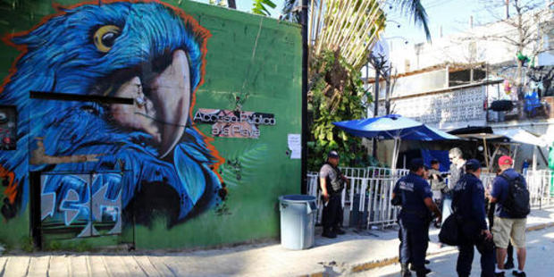 Police guard the entrance of the Blue Parrot nightclub in Playa del Carmen, Mexico following a deadly shooting. Photo / AP