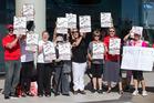 The Ngataringa Bay Action Group protested outside last month's hearing. Photo/Jason Oxenham.