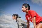 TOP CLASS: Singapore sprinters Kerstin Ong, left, and Shanti Pereria training at Tauranga Domain. PHOTO:ANDREW WARNER