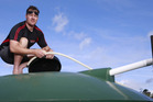 Mangawhai resident Brett Calhoun does what he can to fill his and his family's 25,000L water tank Photo / Nick Reed