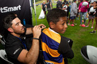 ACC ambassador All Black Nehe Milner-Skudder signs 11-year-old Gideon Lasaga's jersey at the Bayleys National Sevens. Photo/Ben Fraser