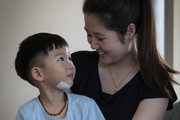 Three-year-old Harry Wang is comforted by his mum Barbara Ding at their Sandringham home. Photo / Greg Bowker