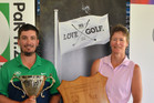 TOP EFFORT: Brent Curnow and Shelly McElroy celebrate winning New Zealand Mid-Amateur titles at Omanu. PHOTO: SUPPLIED
