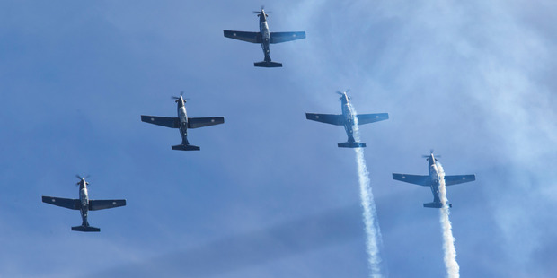 Five RNZAF T-62 Texan II aircraft performing an aerobatic display above Ohakea Base. PHOTO/Mark Mitchell