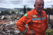 Thames Valley principal rural fire officer Paul Shaw in front of a house that was destroyed by fire in Whitianga. Photo / Belinda Feek