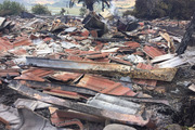 By this morning, all that remained of the historic Wilderland Sustainable Community - an icon of Coromandel for more than 50 years - was a mess of burnt rubble and torn corrugated iron. Photo / Belinda Feek
