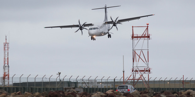 Loading An Air New Zealand passenger plane landing in strong cross-winds at Wellington Airport. Photo / Mark Mitchell