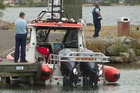 FOUND: The police and Coastguard were present when the body was brought ashore. PHOTO/STEPHEN PARKER