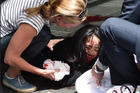 An injured woman in Bourke St, Melbourne Photo / Tony Gough, News Ltd