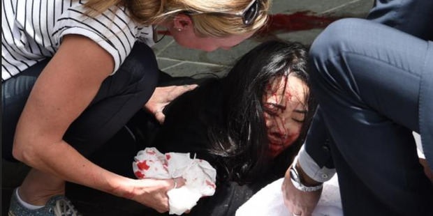 An injured woman in Bourke St, Melbourne. Photo /  Tony Gough / News Limited