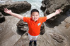 BEACH BOY: Chinese TV star David Zhang, 8, soaks in the sun at Mount Maunganui. Photo / John Borren
