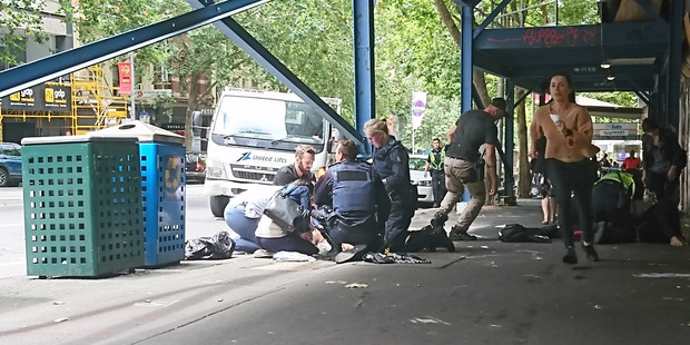 Loading Police and emergency services at the scene. Photo / AAP