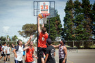 IN CONTROL: W.O.S. player Sam Paterson makes a basket versus Anytime Anyplace at the Burger King 3x3 at Blake Park on Saturday. PHOTO: ANDREW WARNER
