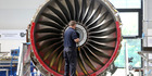 An employee works on a Trent 700 aircraft engine on the production line at the Rolls-Royce Holdings Plc factory in Derby, U.K. Picture / Bloomberg
