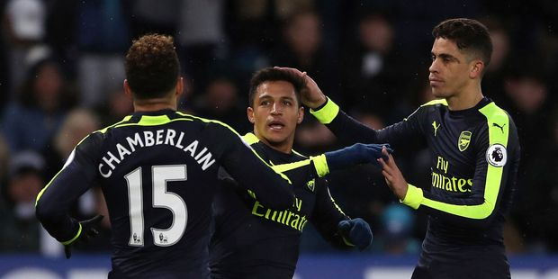 Arsenal's Alexis Sanchez, center, celebrates scoring his side's fourth goal of the game during the English Premier League soccer match between Swansea City and Arsenal. Photo / AP.