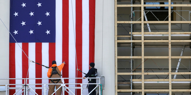 Workers install a flag outside the US Capitol in Washington. Photo / AP