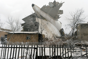 The tail of a crashed Turkish Boeing 747 cargo plane lies at a residential area outside Bishkek, Kyrgyzstan. Photo / AP