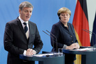 Bill English and German Chancellor Angela Merkel address the media during a joint news conference as part of a meeting at the chancellery in Berlin. Photo / AP