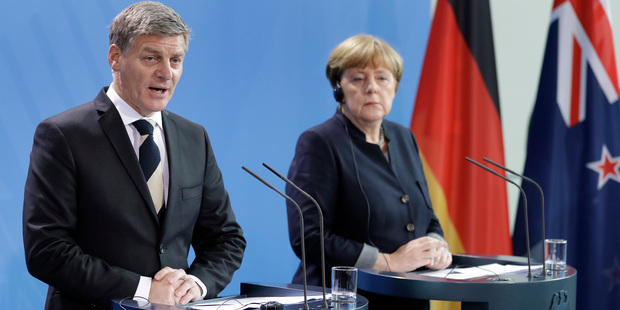 Loading Bill English and German Chancellor Angela Merkel address the media during a joint news conference as part of a meeting at the chancellery in Berlin. Photo / AP