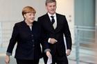 Bill English met the European big wigs, including German Chancellor Angela Merkel. Photo / AP