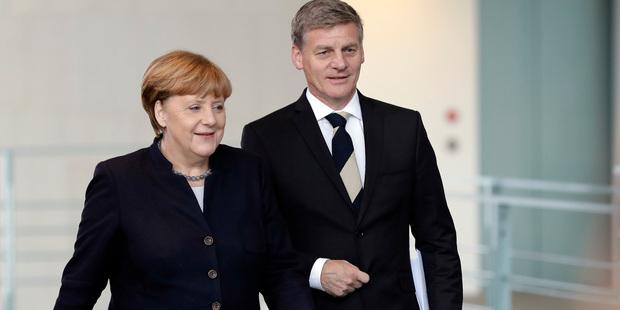 Loading Bill English met the European big wigs, including German Chancellor Angela Merkel. Photo / AP