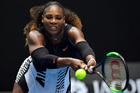 United States' Serena Williams reaches for a shot to Switzerland's Belinda Bencic during their first round match at the Australian Open tennis championships. Photo / AP.
