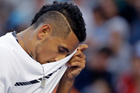 Australia's Nick Kyrgios wipes his face while playing Italy's Andreas Seppi during their second round match at the Australian Open. Photo / AP.