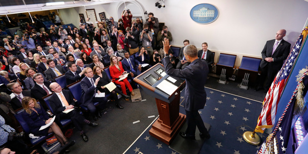 President Barack Obama waves at the conclusion of his final presidential news conference. Photo / AP