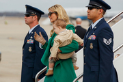 Ivanka Trump carries her son Theodore Kushner, as they arrive at Andrews Air Force Base. Photo / AP