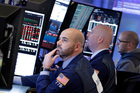 Fred DeMarco and fellow traders work on the floor of the New York Stock Exchange. Photo / AP