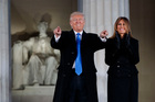 President-elect Donald Trump, left, and his wife Melania Trump arrive to the 'Make America Great Again' Welcome Concert at the Lincoln Memorial. Photo / AP