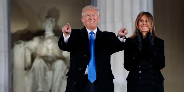 Loading President-elect Donald Trump, left, and his wife Melania Trump arrive to the 'Make America Great Again' Welcome Concert at the Lincoln Memorial. Photo / AP