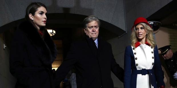 Director of Strategic Communications Hope Hicks, Senior Counselor Steve Bannon and Kellyanne Conway arrive for the inauguration. Photo / AP