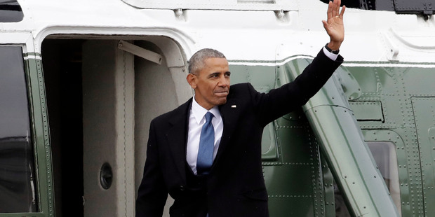 Former President Barack Obama waves as he boards a Marine helicopter during a departure ceremony on the East Front of the U.S. Capitol in Washington. Photo / AP