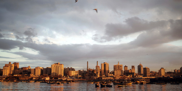 The sun sets over Gaza City. Photo / AP